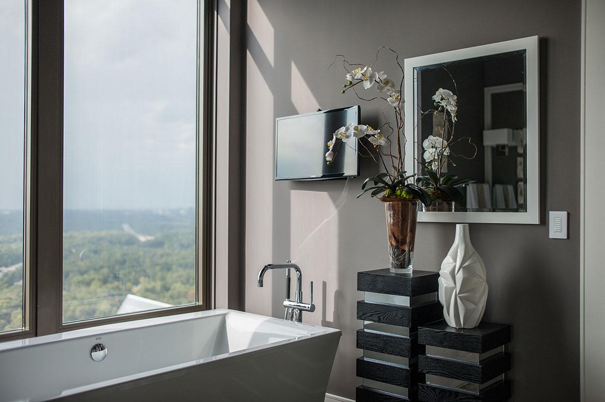 Modern bathroom with framed mirror