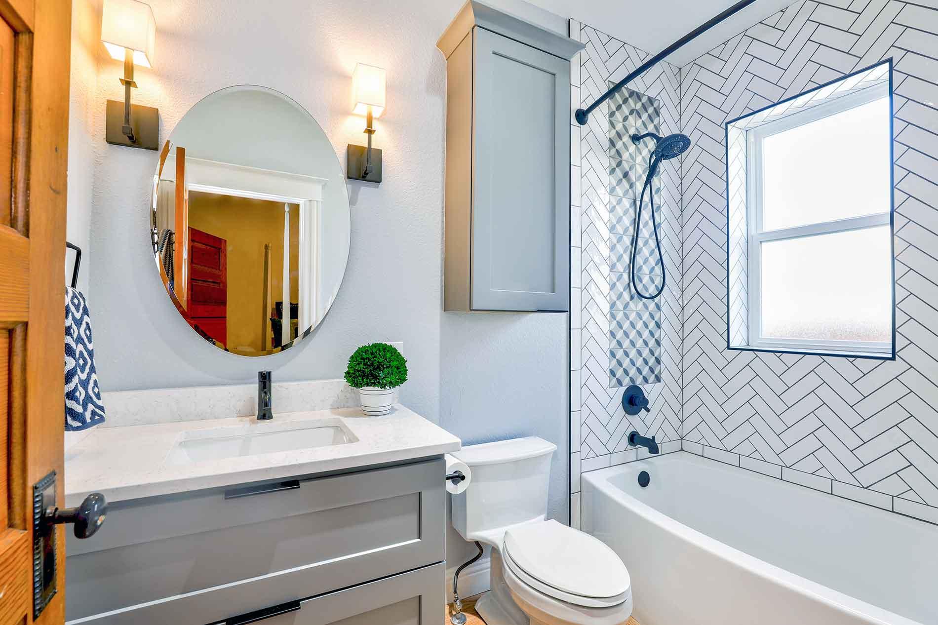 blue-themed bathroom with herringbone tile