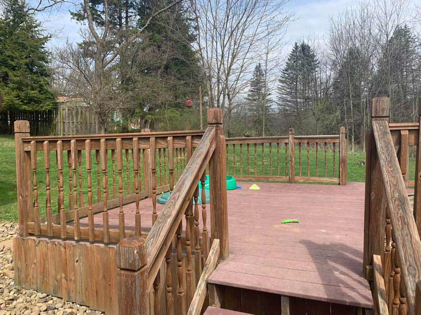 free standing deck in a yard