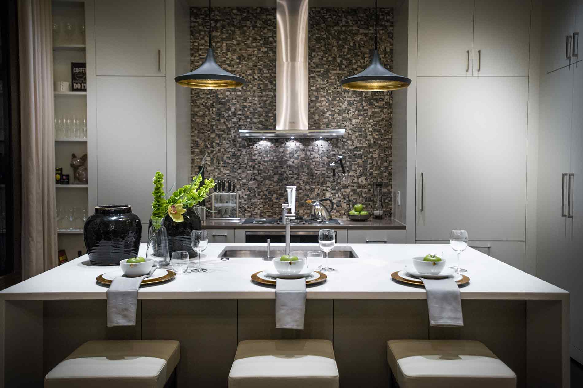 kitchen with tiled backsplash from counter to ceiling