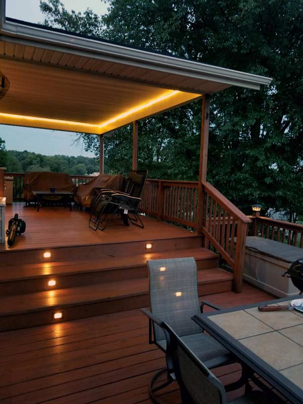 multi-level deck with furniture and table