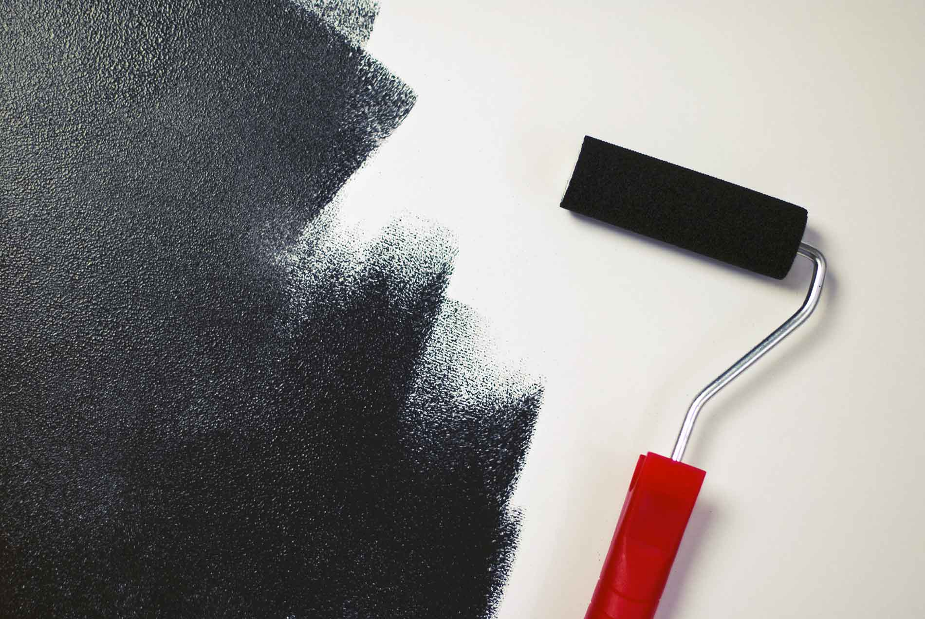 red paint roller with black paint