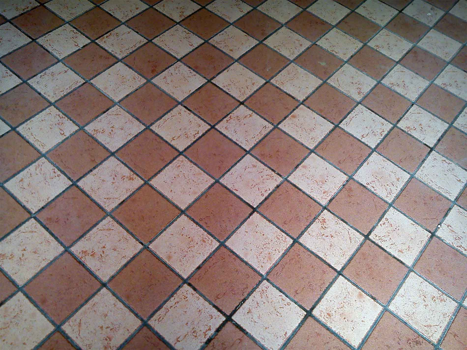 brown and white quarry tiles with grey grout