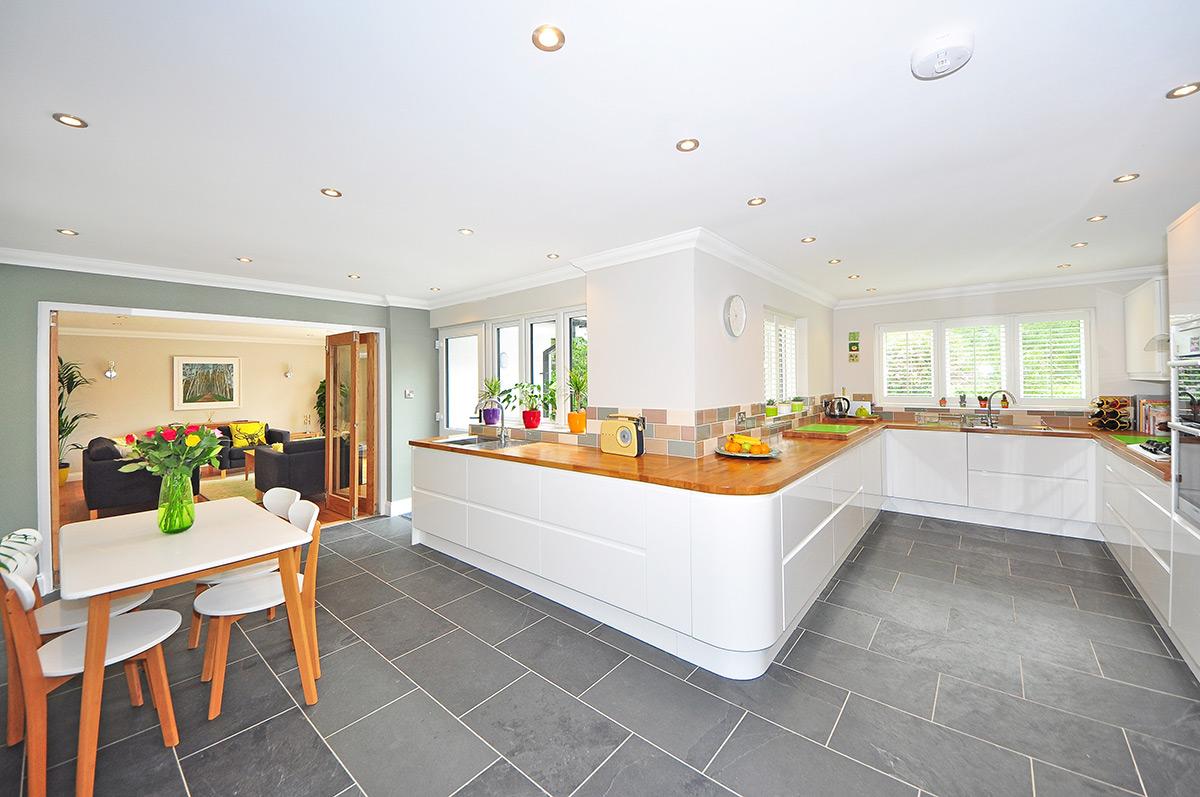 modern kitchen with grey tile flooring