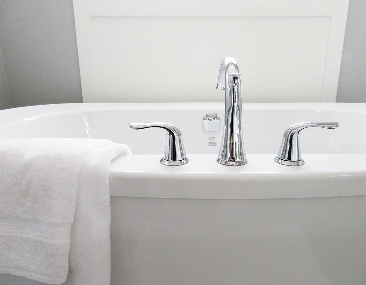 White bathtub with chrome faucet
